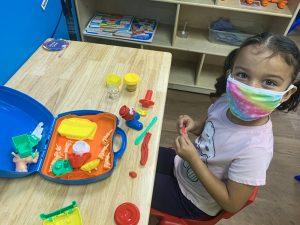 Preschool girl wearing mask